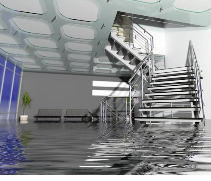 flooding in large room with staircase partially submerged in water