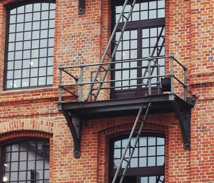 2 fire escapes on a red brick building.