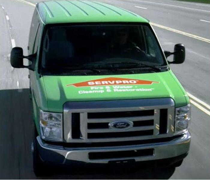 Green SERVPRO van driving down the road